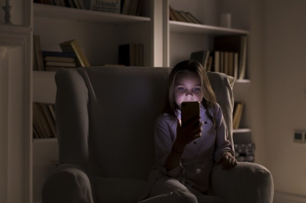 teenagers playing with phone before bed-